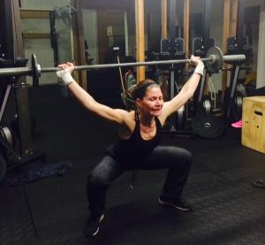 Erin fighting through the Veteran's Day Hero WOD